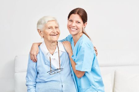 Nursing service wife and happy elderly woman in retirement home or home visit 写真素材