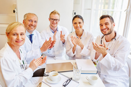 Successful doctors applauding as a team Stock Photo