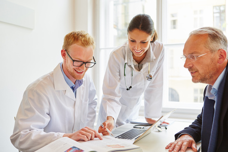 Patient with physician and doctor during consultation