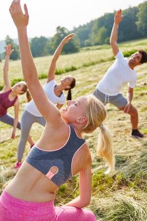 Young people in aerobics workout class for good health
