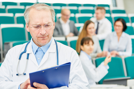 University medicine professor with competence giving medicine apprenticeship to doctors