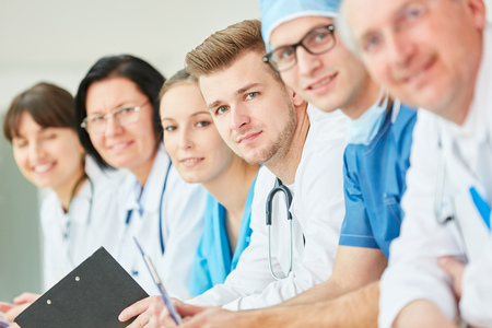 Young doctor and collegues as successful clinic team Stock Photo