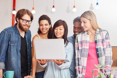 Business startup team with laptop makes marketing in social media