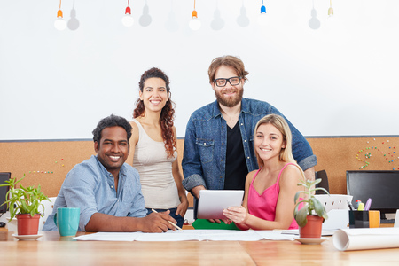 Interracial startup group as a team in business meeting Stock Photo