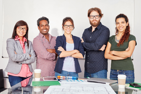 Startup team standing with self confidence in business office