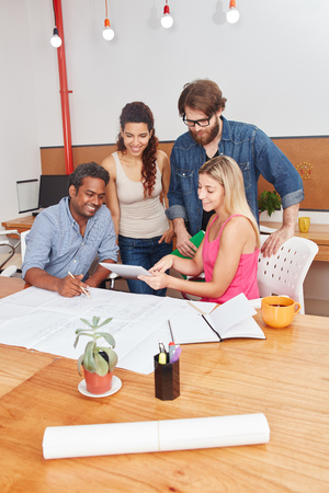 Startup team discussing project plan in meeting Stock Photo