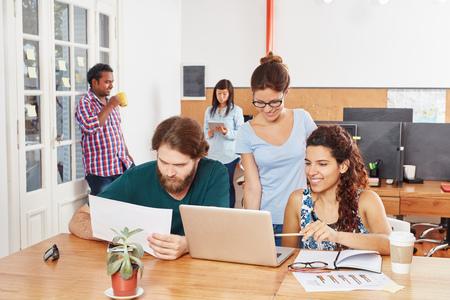 Business teamwork workshop in coworking office