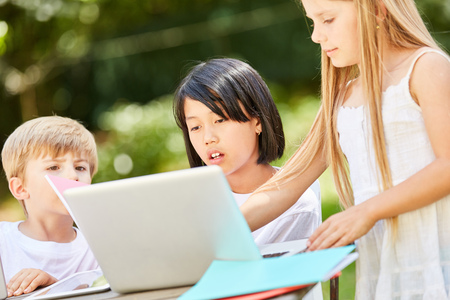 Girls learn together at the Tablet PC in the computer course of a preschool Stock Photo