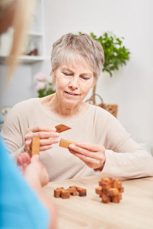 Senior woman with Alzheimers dementia making memory training excercise