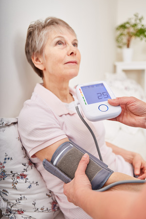 Blood pressure control for senior woman with blood presure meter
