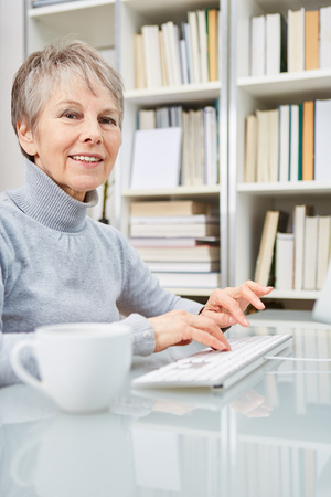 Senior businesswoman working with computer at home office