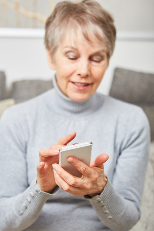 SMS written by senior woman using smartphone