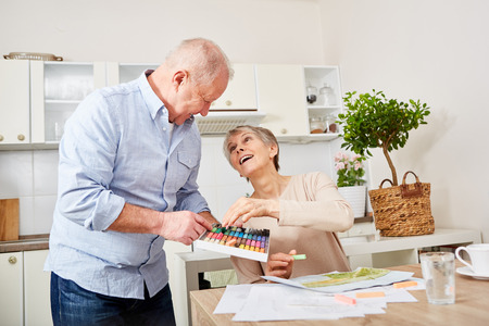 Creative senior woman with dementia painting with husband