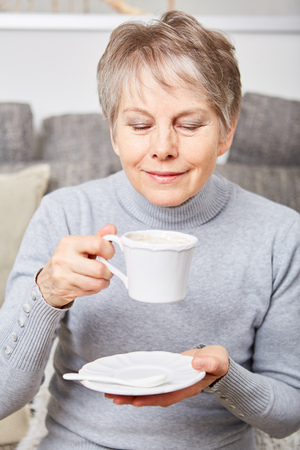 Senior woman dinking a cup of coffe  with relaxation