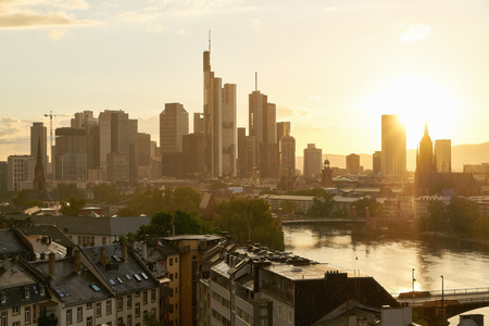 Skyline of Frankfurt am Main in the evening with sun and many skyscrapers