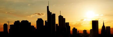 Big city silhouette skyline of Frankfurt am Main at sunset as a panorama