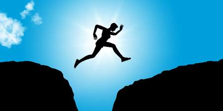 Fitness person jumps between rocks as concept image for courage and success
