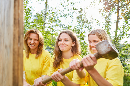 Women as construction workers do teamwork in a teambuilding workshop Stock Photo