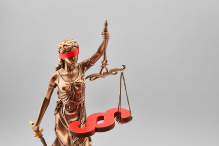Blind Justitia with paragraph on the scales as law concept Stock Photo