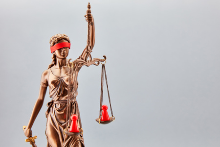 Justitia as dispute mediator in conflict with conflict parties on Libra as a concept Stock Photo