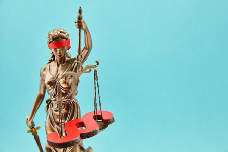 Blind Justitia with paragraph on Libra as law concept in front of a blue background Stockfoto - 102243216