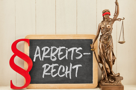 German word Arbeitsrecht (labor law) as law concept on blackboard with law symbols