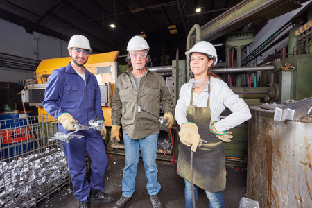 Workers as foundry factory team as a group