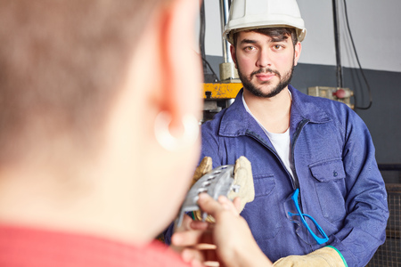 Man as industry apprentice with protective clothing in metallurgy workshop Stock Photo