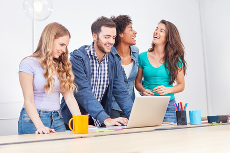 Young business start-up team is having fun with a computer training on laptop