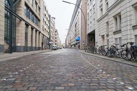 Empty road consisting of paving stones in a German city Stockfoto