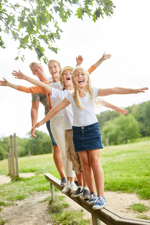 Happy family and kids do fitness on the trim you path Stock Photo
