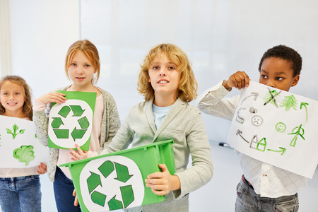 Children as elementary school creative team are planning a recycling ecology project