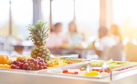 Fresh fruit to choose from at the buffet in the cafeteria of a school Stock Photo