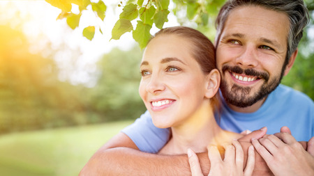 Happy couple in love hugging  in the nature in summer Stock Photo