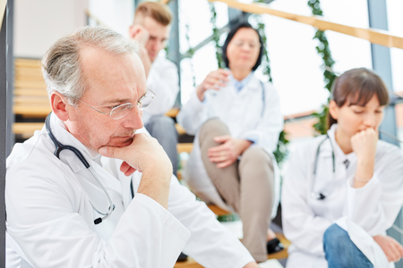 Doctors brainstorming on difficult problem on hospital staircase