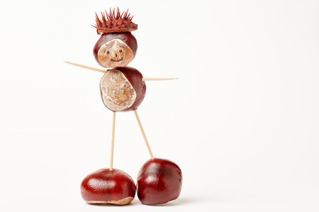 Chesnut man made with chestnuts and toothpicks in autumn