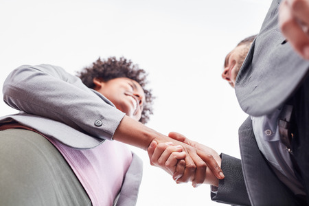 Two business partners greeting or transporting with shakehands