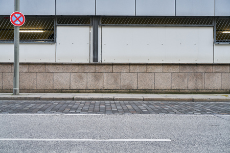 Empty street and sidewalk in front of a wall in the city of Hamburg