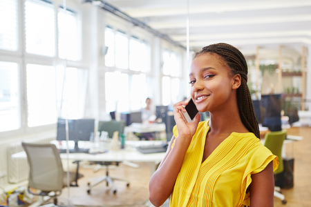 Young woman calling business hotline for service at internship in start-up