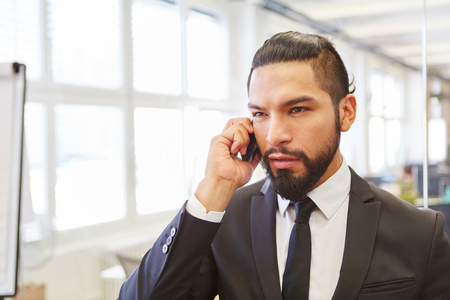 Man as manager in business call at his office Stock Photo