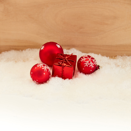 Christmas decoration with red gift and Christmas baubles