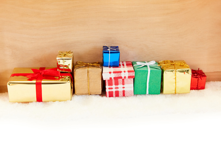 Many colorful presents for Christmas as a background in front of wood Archivio Fotografico