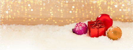 Colorful Christmas background header with gift and bokeh