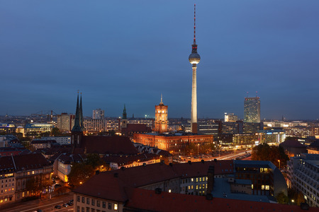 Berlin City at night with TV Tower and Red Town Hall on Alexanderplatz Stock Photo