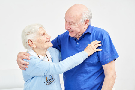 Happy loving senior couple lovingly hugging each other at home Stockfoto - 116238918