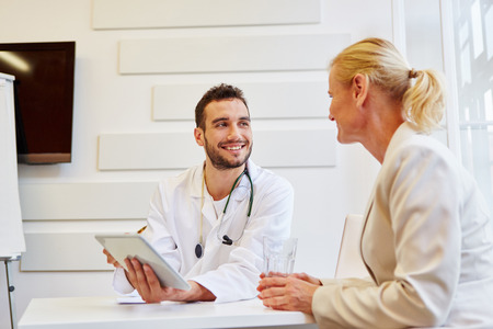 Doctor in consultation with patient that trusts him