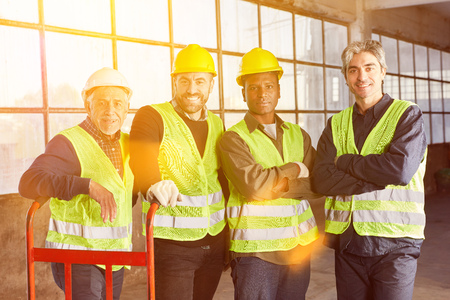 Multicultural group warehouse workers as a team in the industry Banque d'images