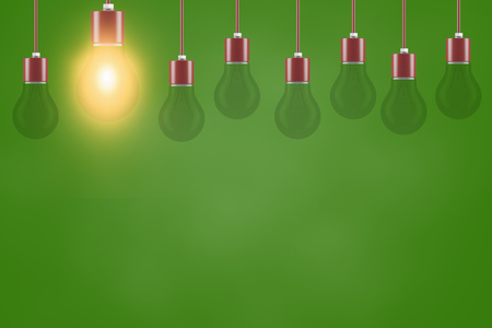 Many light bulbs as energy saving concept in front of a green background (3D Rendering)