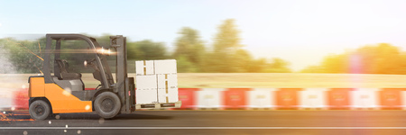 Fast forklift with boxes driving on a highway (3D Rendering)
