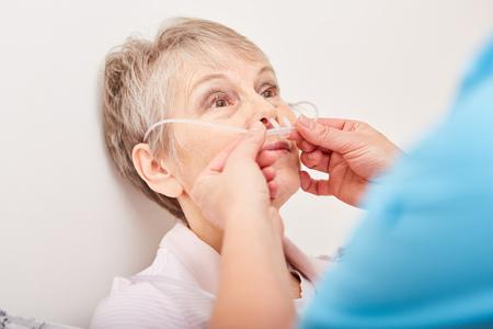 Nasogastric probe treatment therapy for senior woman
